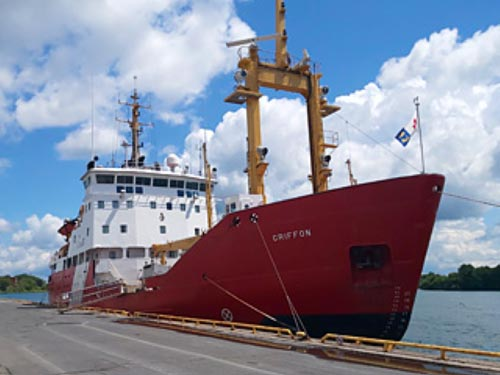 Red coast guard ship docked at the Port Lands
